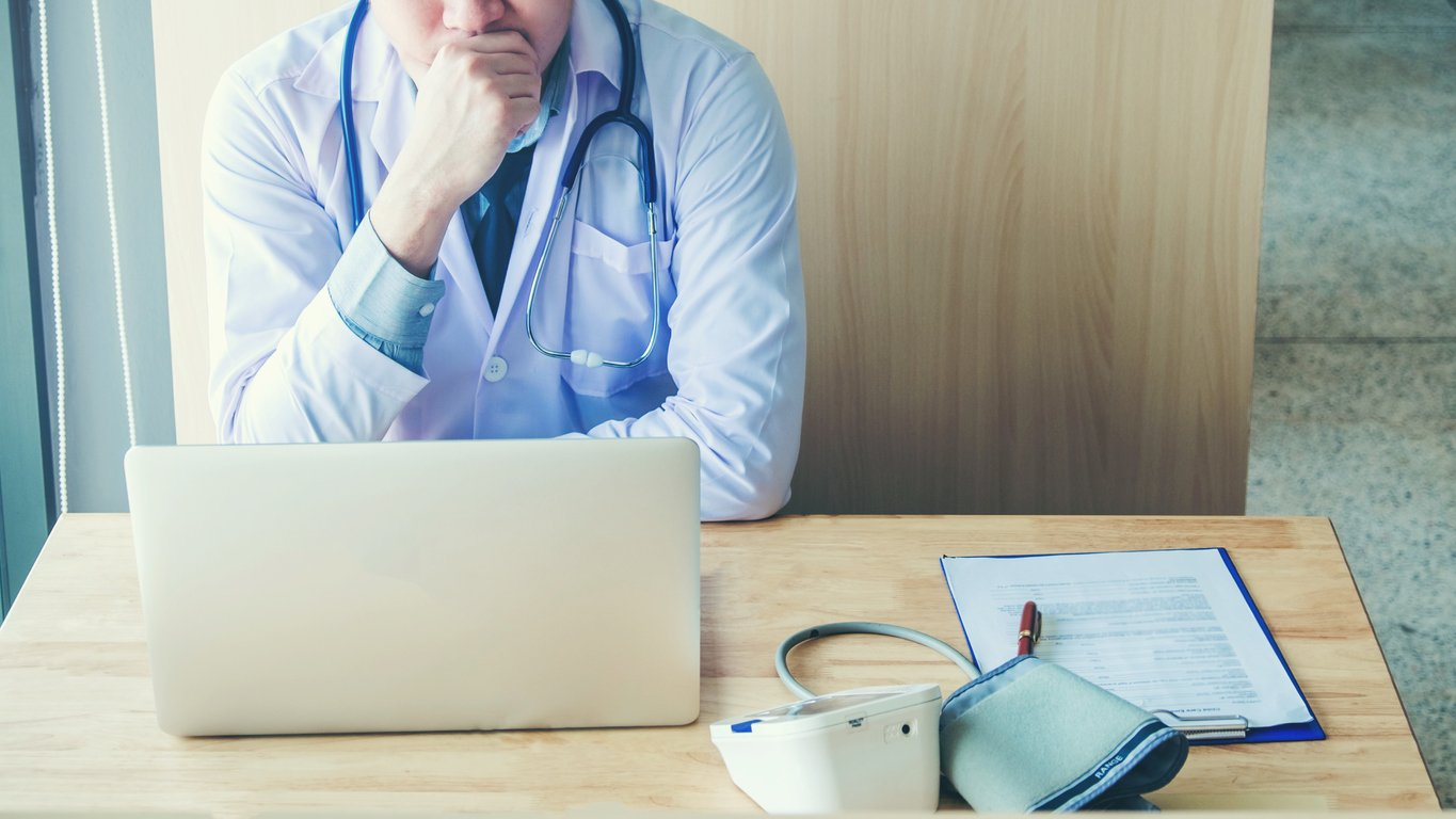Doctor-is-working-in-office-sitting,-thinking-about-Disease-problem-of-patient-994672252_1369x770-1